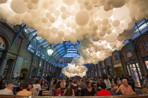 A Cloud of 100,000 Illuminated Balloons Suspended Inside